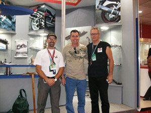 Foto: Tite, Edson e Renzo no salÆo