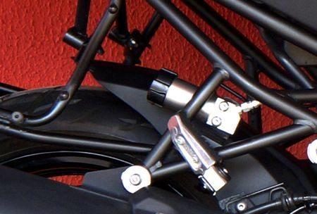 Botão de ajuste da pré carga da mola traseira