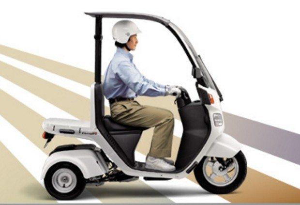 Pequeno tricíclo fabricado pela Honda no Japão - pode ter motor elétrico ou à gasolina, similar ao da PCX